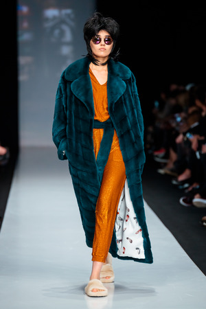furs: MOSCOW, RUSSIA - MARCH 14, 2017: Model walk runway for EKATERINA AKKHUZINA for EKATERINA FURS catwalk at Fall-Winter 2017-2018 at Mercedes-Benz Fashion Week Russia.