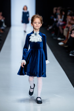 MOSCOW, RUSSIA - MARCH 15, 2017: Model walk runway for ALISIA FIORI catwalk at Fall-Winter 2017-2018 at Mercedes-Benz Fashion Week Russia. Kids fashion. Fashion Time Designers.