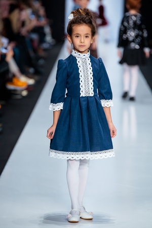 famous industries: MOSCOW, RUSSIA - MARCH 15, 2017: Model walk runway for ALISIA FIORI catwalk at Fall-Winter 2017-2018 at Mercedes-Benz Fashion Week Russia. Kids fashion. Fashion Time Designers.
