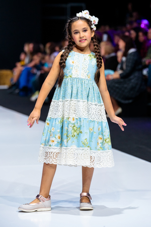 MOSCOW, RUSSIA - OCTOBER 28, 2017: Model walk runway for LANA2ROCK by ASUTINA JULIA for KIDS catwalk at Spring-Summer 2018 Season Moscow Fashion Week. Kids fashion.