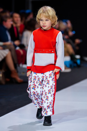 MOSCOW, RUSSIA - OCTOBER 28, 2017: Model walk runway for FASHION BOOK by ALENA STEPINA catwalk at Spring-Summer 2018 Season Moscow Fashion Week. Kid's fashion. Sajtókép