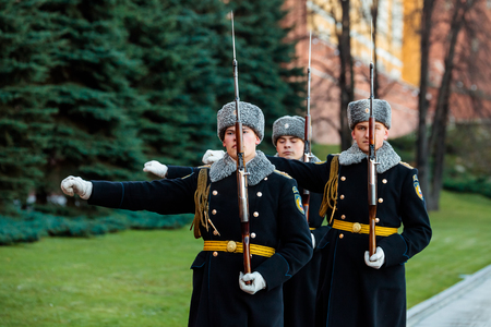 MOSCOW, RUSSIA - NOVEMBER 08, 2017: Hourly change of the Presidential guard of Russia at the Tomb of Unknown soldier and Eternal flame in Alexander garden near Kremlin wall. Autumn view. Editorial