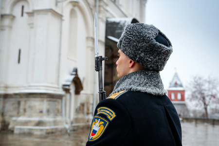 MOSCOW, RUSSIA - DECEMBER 09, 2017: The Honor Guard of the Presidential Regiment of the Service of Moscow Kremlin's Commandant of the Federal Guard Service of the Russian Federation. Winter view. Cathedral Square, Kremlin, Moscow. Editorial