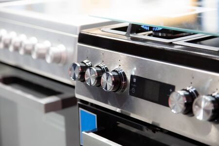 handles of a gas or electric stove, close-up, side view, soft focus Banque d'images