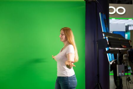 young beautiful caucasian girl is walking on a background of green screen. on background backstage.