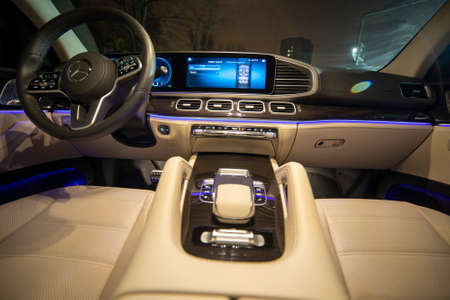 Moscow, Russia - December 24, 2019: Empty interior of light leather interior of premium SUV Mercedes GLS class night shooting. with colored LED ambient backlight