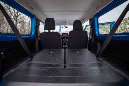 huge empty car trunk in interior of compact suv. rear seats in offroad suv car folded in flat flor.