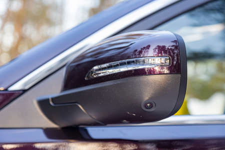 option of a 3d cam monitor system in a modern car. close-up side view rearview mirror of modern car with camera of parking assist