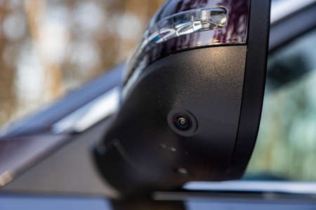 surround cam monitor system system in a modern car. side view rearview mirror of modern car with round view camera