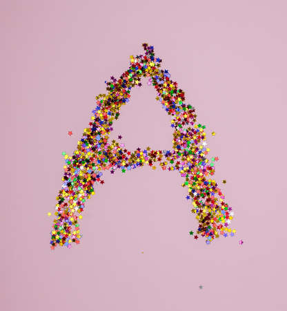 Letter A in different color little stars on pink background. Figures A made of glitter on pink backdrop. Letter A made from multicolored confetti.