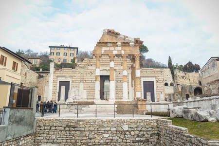 Brescia, Italy - December, 2015: Capitolium or the Temple of the Capitoline Triad in Brescia was the main temple in the center of the Roman town Brixia. It is represented at now by fragmentary ruins