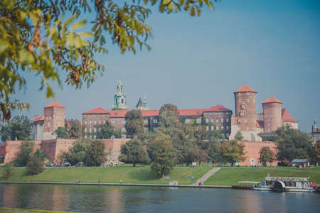 The Wawel royal Castle in Krakow, Poland. Built at the behest of King Casimir III the Great. The castle was one of the largest in Poland. View from across the river Vistula, Wisla.