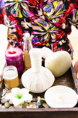 rejuvenate: Spa treatment with towels and herbal creams and scrubs on beautiful soft bakcgorund