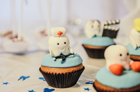 Beautiful cake with medic tooth hero on top for children first tooth party
