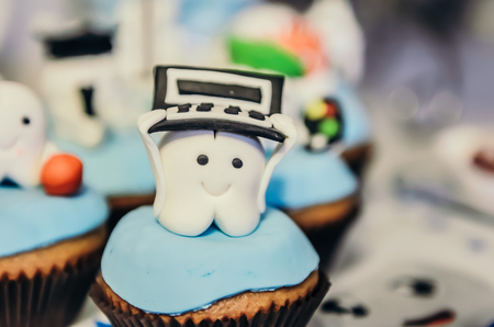 boxing day: Beautiful cake with programmer tooth hero on top for children first tooth party Stock Photo