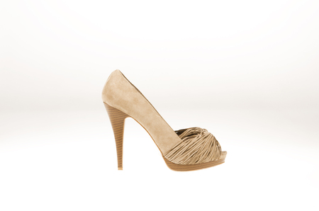 Brown suede shoe on white background