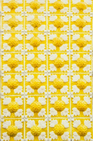 Gorgeous seamless pattern from yellow and white Moroccan, Portuguese tiles, Azulejo, ornaments. Can be used for wallpaper, pattern fills, web page Stock Photo