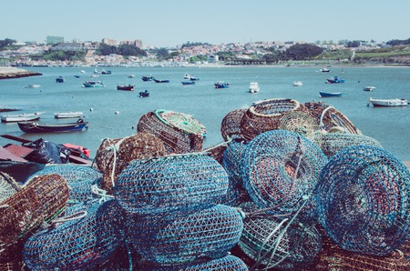 ploy: Fishing traps and anchored fishing boats in Porto, Portugal