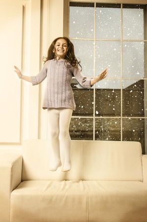 room to let: Beautiful happy Lille girl posing in studio Stock Photo