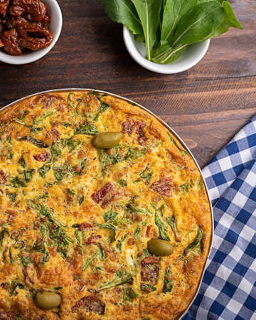 Egg omelet with sun-dried tomatoes and arugula