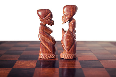 clarify: Couple, husband and wife ,represented by two pieces of wooden chess, king and queen , facing each other