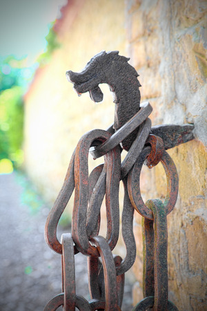 enchain: Chain and hook of medieval origin, the concept of compulsion, bond, shackling