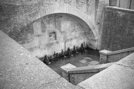 bn: Ancient tub with fountains for washing and watering the animals in a medieval village (B&N)
