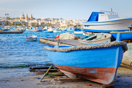 aground: Luzzu aground in Marsaxlokk, Malta