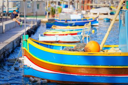 docker: Luzzu moored in Marsaxlokk, Malta Stock Photo