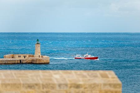 Tourist ship enters the port of Valletta, Malta Stock Photo