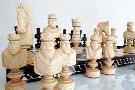 chellange: Chess pieces on wood board Stock Photo