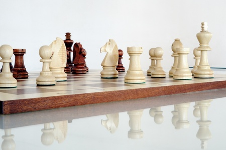 Chess pieces on wood board Stock Photo