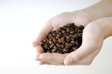 coffee beans in the womens hands