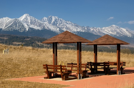 Car resting with shelters and benches under the High Tatras, Slovakia Stock Photo