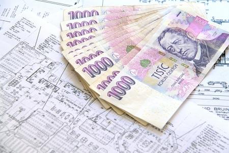 banknotes on blueprints photo