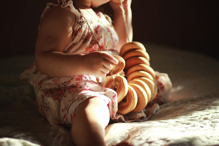 Baby girl playing with yummy donut