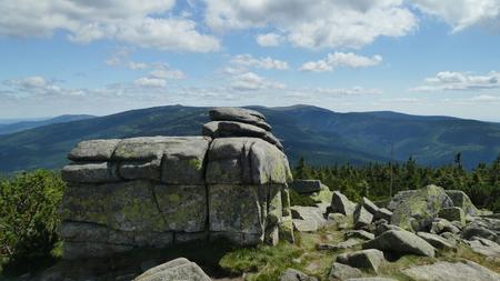 2017 Poland Sudety Range, Karkonosze Mountains. A boulder with a view of the ?nie?ka peak