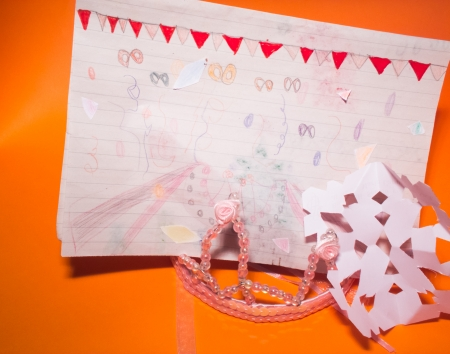 coronet: child sketch and carnival coronet on orange background