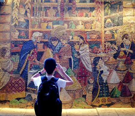 boy photographing murals in jerusalem
