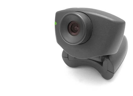 A black USB Internet Webcam with red lens and green led light Stock Photo