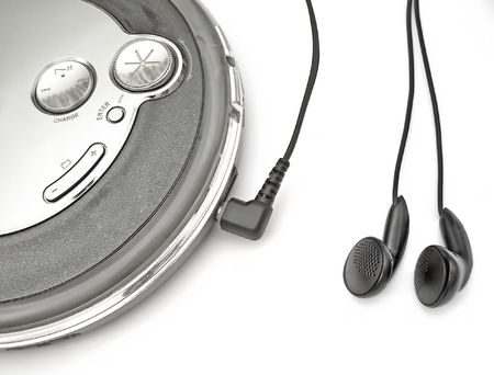 an mp3/cd player with ear-buds plugged in Stock Photo - 413433