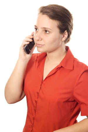 Young woman wearing a red shirt talking on a cellphone. White background. Stock Photo - 3736751