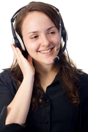 A pretty secretary listening with her head-set and smiling. White background.