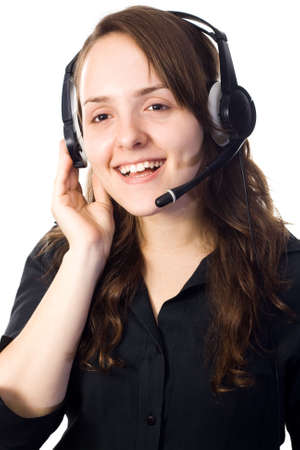An attractive and smiling auburn receptionist talking with a head-set. White background.