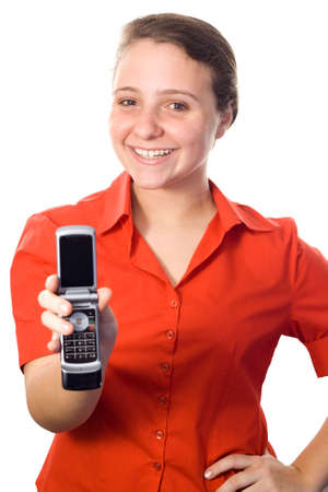 Beautiful young woman, wearing a red shirt, showing a mobile phone with her right hand. White background.