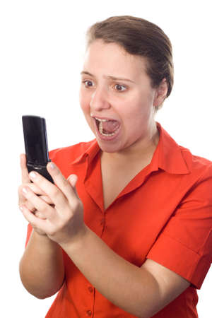 Business-woman, on a red shirt, screaming angrily at her cellphone. White background. Stock Photo