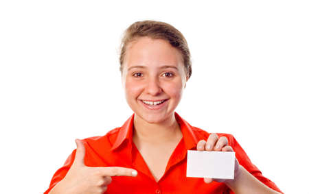 Smiling businesswoman pointing to a white card. White background. photo