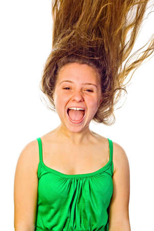 Woman screaming with her hair blowing. White background. photo