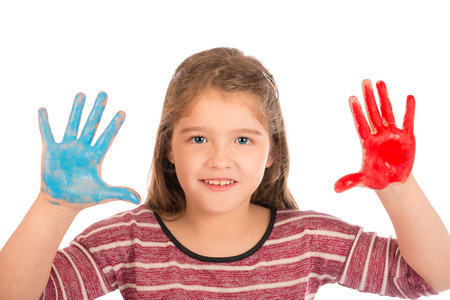 Cute little girl playing with red and blue paint showing her hands. Stock Photo