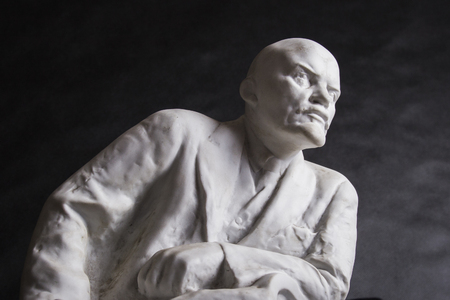made russia: plaster sculpture of Lenin on a black background
